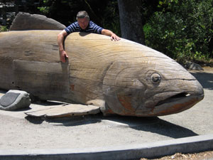 21 foot Salmon sculpture carved out of wood by Floyd Davis