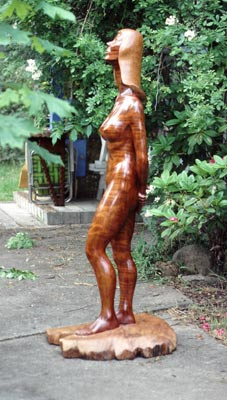 life-size Nude Madonna woman carved in wood by Floyd Davis wood sculptor
